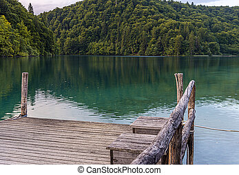 Wooden pier on a calm evening lake