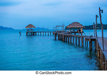 wooden pier on a tropical island