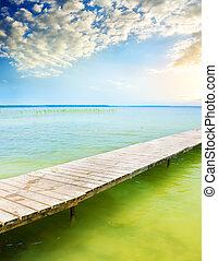 Wooden pier on beautiful lake.