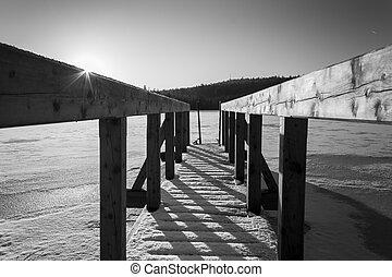 Wooden Pier on Frozen Lake Black and White Winter Photo