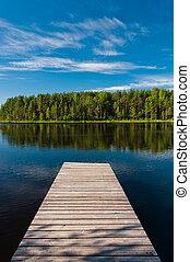 Wooden pier on lake symmetrical scene