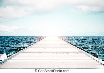 Wooden pier on sea background