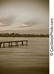pier on the lake in summer evening