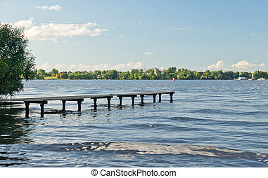 wooden pier on the lake on summer