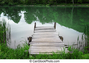 Wooden pier on the lake.
