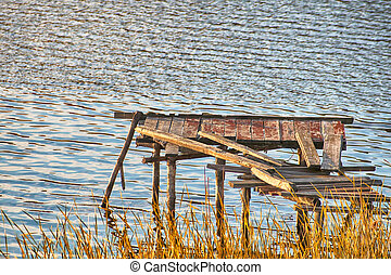 Wooden pier on the river in the evening