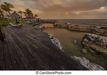 Wooden pier overlooking the sea at dusk