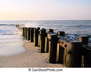 Wooden Pier reaching into the Ocean