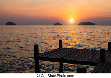 Wooden pier. Sunset on the Gulf of Thailand.