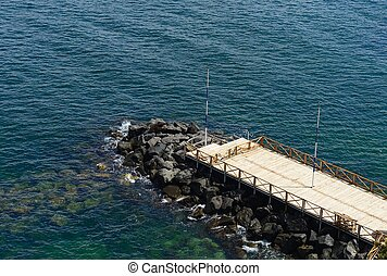 wooden pier surrounded by the sea a