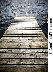 Wooden pier. - Weathered wooden pier - intentional...