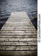 Wooden pier. - Weathered wooden pier - intentional ...
