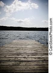 Wooden pier. - Weathered wooden pier submerged in water - ...