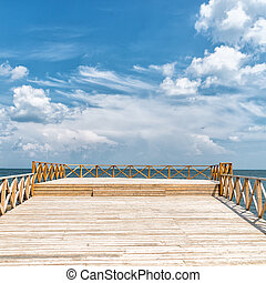Wooden pier with blue sea