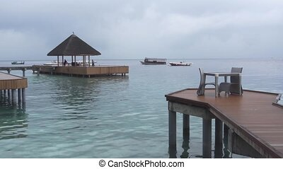 Wooden Piers of a Luxury Resort in the Maldives - Boats...
