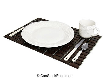 Wooden place mat with white dinner plate setting