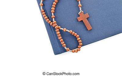 Wooden plain rosary on Bible.