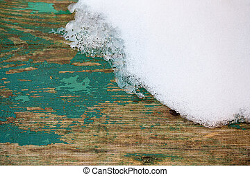 Wooden plank and snow background
