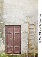 wooden plank door and ladder