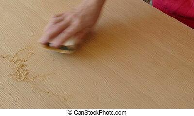Wooden plank sanding - Closeup of worker hand sanding wooden...