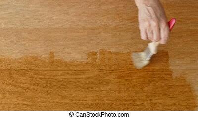 Wooden plank varnishing