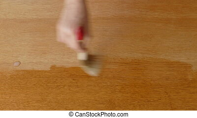 Wooden plank varnishing - Varnishing of wooden plank,...
