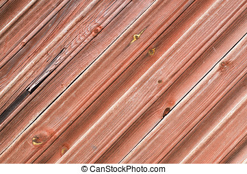 Wooden plank wall painted red, diagonal pattern