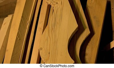 Wooden planks and boards at the joinery. Different wooden ...