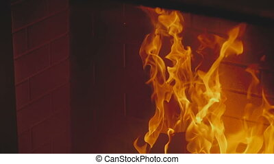 Wooden planks are burning in a fireplace