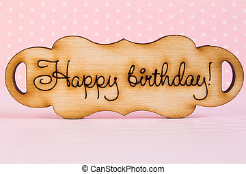 """Wooden plaque with the inscription """"Happy Birthday"""" on pink back"""