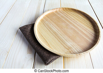 Wooden plate on wooden background