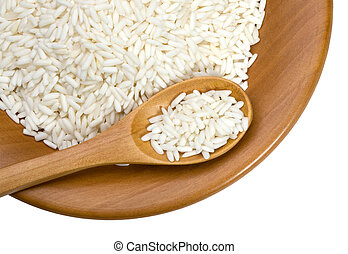 wooden plate with grains of rice