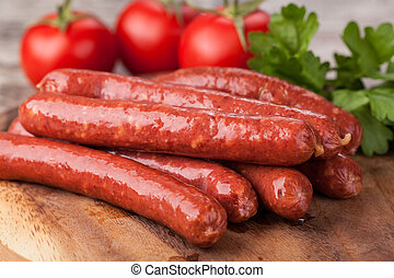 sausages - wooden Plate with hot sausages