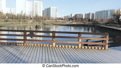 Wooden platform in hoarfrost - On the bank of the city pond...