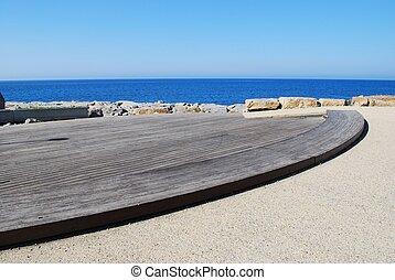 Wooden platform next to the sea