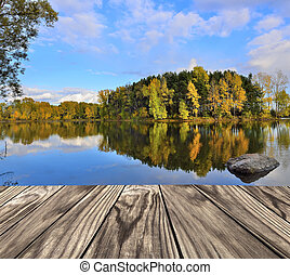 Wooden platform over the autumn lake