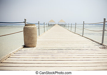 Wooden pontoon stretching into the Red sea