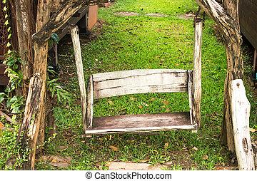 wooden porch swing in garden