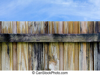 wooden privacy fence with blue sky