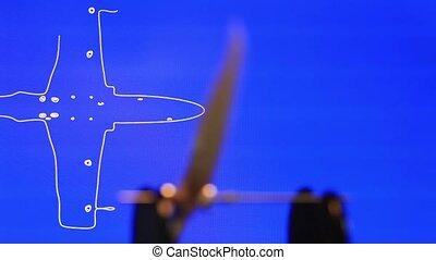 wooden propeller rotating - Propeller  balancer close to