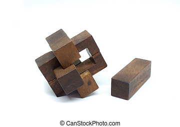 Wooden puzzle isolated on white background. (Selective focus)