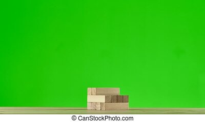 Wooden puzzles jenga gather in tall tower. Stop motion,...