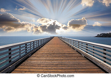 Wooden quay a pier at Pacific coast USA. A sunset and...