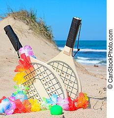 wooden rackets and hawaiian necklace