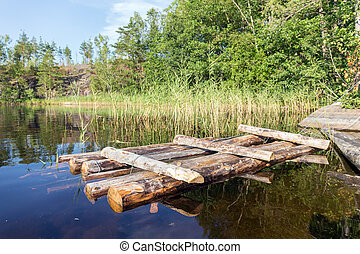 wooden raft near the shore