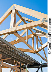 Wooden rafters against the blue sky