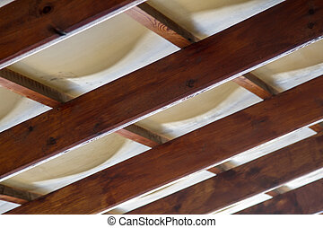 wooden rafters under the ceiling of the roof