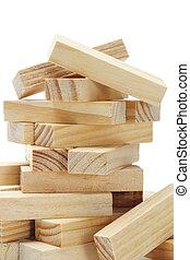 Stack of wooden rectangular blocks on white bcakground