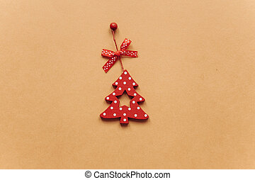 Wooden red toy in the form of a Christmas tree.