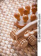 Wooden refreshing massager on wicker mat healthcare concept